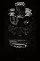 Aftershave Bottle (Dave Sexton) Tags: monochrome black white bw bottle aftershave azaro wanted by nightblack background metallic reflections panasonic lumix s1r 24105mm dxo photolab on1 photoraw affinityphoto