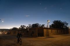 Biking on San Pedro Streets (MrBlackSun) Tags: moon 3dayoldmoon eclipse tse tse2019 nikon d850 dusk twilight sunset sanpedro sanpedrodeatacama atacama chile