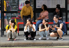 `2828 (roll the dice) Tags: travel girls people sexy london smile fashion happy pretty sad camden transport chinese surreal line busstop korean mad w1 westend reaction newoxfordstreet urban weather legs sunny squat hips unknown unaware uk portrait classic tourism canon candid strangers tourists shopping natural angry shops traffic mobile phones fila shoot angle low