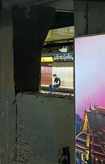 Hole in the Wall - Metro Station, Barcelona, Spain (TravelsWithDan) Tags: man wall hole metro subway tube holeinthewall bench ad underground city urban night europe spain barcelona candid canong9x