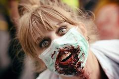 A Nurse of Death (henriksundholm.com) Tags: portrait portraiture people woman lady female blonde vignette dof depthoffield nurse face smile scream blood wound zombie zombiewalk teeth eyes bangs mouthguard horror parade stockholm sverige sweden 50mm