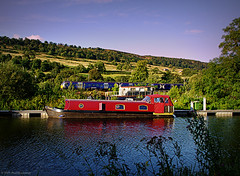 Trains and Boats and............. (Rollingstone1) Tags: forthandclydecanal bowling scotland water boat train hills hillside sky outdoor blue red colour vivid trees art artwork landscape