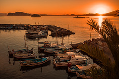 Aegean sunset..... (Dafydd Penguin) Tags: sun sunset islands sea water orange harbour harbor port dock quay view vista fishing vessel boats hydra saronic gulf greece aegean meditierranean leica 10 35mm summicron f2 asph