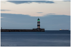 The Lighthouse , Fisherman And Ship (Steven Peachey) Tags: seaham lighthouse seascape canon bluehour canon5dmarkiv leefilters lee09gnd canonef1635f4l seahamlighthouse beach stevenpeachey countydurham seahamharbour 5dmarkiv longexposure le explored explore