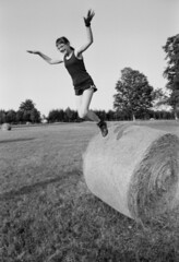 About the art of flying / O sztuce latania (Piotr Skiba) Tags: child flying field summer bw monochrome ilfordfp4 eos poland pl piotrskiba human jump wings film