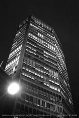 Beograđanka at night 2 (B&W) (srkirad) Tags: architecture building skyscraper beogradjanka beograđanka beograd belgrade serbia srbija night tall lights sky dark dramatic landmark windows