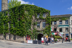 HEBDEN BRIDGE, WEST YORKSHIRE, UK - JULY 14th 2018. View of the old mill on Bridge Gate in the town centre (taylorsally271) Tags: bridge blue building architecture buildings street summer england people streets history mill industry tourism rural pub outdoor culture sunny landmark tourist shops editorial northern hebden pennines hebdenbridge calderdale southpennines uk town yorkshire westyorkshire