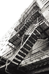 Fire Escape (b/w) (Peter Rea XIII) Tags: art architecture artistsontumblr angle blackandwhite biutifulpics building bnw city cameraraw d300s design experimental gradient imiging industrial lensblr lightisphotography luxlit manchester nikon originalphotographers originalphotography photographersontumblr peterreaphotography photography pws p58 submission streetphotography street telescopical urban xonicamagazine ycphotographs
