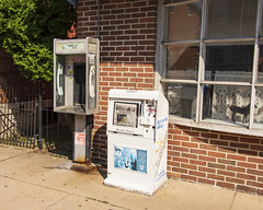 I Can't Talk to You Right Now (trainmann1) Tags: nikon d7200 nikkor 18200mm amateur handheld pa pennsylvania summer july 2019 outside outdoors phonebooth payphone newspaper kutztown