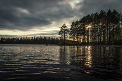Behind (mabuli90) Tags: lake water sun sky clouds tree forest finland nature