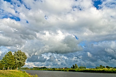 Heavy Clouds (Hindrik S) Tags: clouds wolken nuages bluesky blauw blau weather waar weer wetter wasser water canal kanaal vanharinxmakanaal leeuwarden liwwadden ljouwert kanal vaart feart trees beammen bomen landscape landschap landschaft lânskip panorama scenicsnotjustlandscapes scenery scenic on1photoraw2019 on1pics sonyphotographing sony sonyalpha amount minoltaamount a77ii α77 slta77ii sonya77ii sonyilca77m2 sal1650 sony1650mmf28dtssm f11 16mm 1160