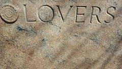 Lovers (Mamluke) Tags: jamesearlefraser fraser 1950 vision word carved stone crack cracked mayomemorial mayopark rochester minnesota mamluke rochesterminnesota rock piedra pietra stein steen pierre carving sculpture brown words mots texte parole palabras woorden