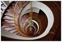 Swirl (frodul) Tags: architektur gebäude geländer gestaltung hochhaus innenansicht kreis kurve lamp lampe linie spiral spirale stair treppe stufe treppenhaus berlin stairway rot red staircase