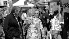 Hug (nige cox) Tags: care flickrfriday hug friends human people chancemeet fennystratford fennypoppers street candid