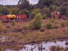 Old Railway (jim2302) Tags: old bog rail railway rust tank caravan ireland water swamp trees heather sky olympus penf