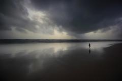 Whats on your mind ? (Debmalya Mukherjee) Tags: debmalyamukherjee canon550d 1018mm wideangle colva goa reflection clouds beach silhouette alone walk