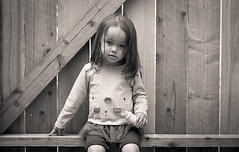 On the Fence (Anthony S Caldera) Tags: daughter backyard fence sitting toddler cute film ilford hp5 nikon fe epson v600 400 bubbles
