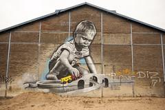 Roosart mural (Arne Kuilman) Tags: 25mm zeiss d700 nederland netherlands roosartpaintings turfhaven mural kid boy roosart doesburg brio trainset playing