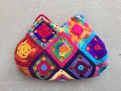 One side of the scrap yarn flamobyant swag bag (crochetbug13) Tags: crochet crocheted crocheting crochetsquares crochetswagbag crochetpurse grannysquarepurse grannysquareswagbag grannysquarebag usewhatyouhave