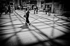 (Camera Freak) Tags: 190817kanazawam10kanazawaishikawaleicam1028mmelmaritjapan kanazawa ishikawa japan station light shadow parasol people human architecture building bnw monochrome