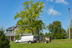 Hitching Up (risingthermals) Tags: blue clear sky usa united states north america people americans trees rural outside vehicle van hitching up home house horse pony green grass tree