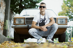 Strassenjunge (NEVEZ P★) Tags: nevezphotography 50mm sony model elias dof berlin germany car portrait fineart art film boy color bokeh light contrast nature street streetphotography people focus outside green yellow orange sunglasses cool attitude