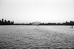Sunset (OzGFK) Tags: 2019 35mm august chm400universal chm400 sydney yashicaelectro35gl afternoon analog blackandwhite film winter sydneyharbour harbourbridge harbour silhouette sunset ferry monochrome bw