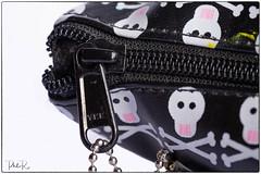 Zip It! (PhilR1000) Tags: closed macromondays macro zip bag skulls pencilcase