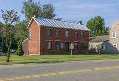 Old Pike County Courthouse Annex — Piketon, Ohio (Pythaglio) Tags: building structure historic ihouse twostory brick flemishbond fivebay centralpassage chimneys metal roof 11windows stone lintels sills courthouseannex government sidewalk street trees piketon ohio pikecounty pik79 annex