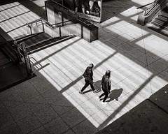 Walkers (Poul-Werner) Tags: bwtrix berlin blackandwhitephotos germany potsdamerplatz xpro2 xf23mm documentary everydayart pattern reportage street tog train travel visualpoetry