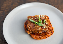 Smoked Korean whole hog terrine on a kimchi pancake with a gochuchang glaze from Feges BBQ (houstonfoodie) Tags: bbq barbecue houston saintarnoldbrewing