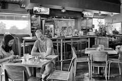 Reading the Menu (Kool Cats Photography over 12 Million Views) Tags: oktraveltakeover architecture artistic bw blackandwhite bar highcontrast highcontrastblackandwhite interior lights light monochrome oklahomacity oklahoma oddsnends photography ricohgrii restaurant streetphotography traveloklahoma