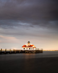 Roanoke Marshes Lighthouse (Vladimir Grablev) Tags: view lighthouse obx landscape sunset northcarolina landscapes longexposure atlanticocean travel scenic attraction historic manteo outerbanks roanokeisland usa water