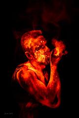 Creation of flame (Soren Wolf) Tags: uv light blacklight black orange red fire ultraviolet powder hand human magic studio neon color colorsuv colors nikon d750 tamron 2470mm lava smoke dust