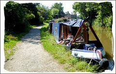 Enjoying the sunshine. (Country Girl 76) Tags: canal leeds liverpool skipton narrow boat barge towpath lady reading sunshine water equipment trees flowers