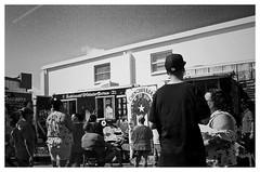 waiting in line (J.Armando Serrano Photography) Tags: retina bw arista film tampa ektar 50mm people kodak camera vintage blackwhite iso400