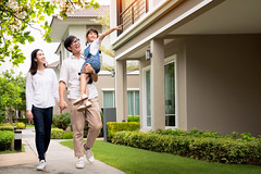 Beautiful family portrait smiling outside their new house (I love landscape) Tags: insurance property love rent chinese kid residential togetherness smile thai mum cute hispanic village kids sweet day japanese girl daughter young family outdoor lifestyle home people asian together house father woman parents child outside female thailand mother beautiful happy dad portrait asia lovely person cheerful group mom garden healthy summer