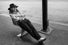 Full Tilt (johnjackson808) Tags: vancouver sidewalk monochrome granvillest people street streetphotography relaxing cowboy blackandwhite bw downtown