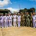 U.S. Marines, Sailors and Royal Thai Navy Sailors gather following a showing of amphibious assault vehicles