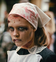 A Zombie Maid (henriksundholm.com) Tags: portrait portraiture face people girl woman female maid costume cosplay parade makeup blood horror zombie zombiewalk dof depthoffield bokeh 50mm wounds dead death terror stockholm sverige sweden