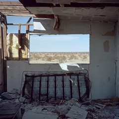 room with a view. mojave desert, ca. 2018. (eyetwist) Tags: eyetwistkevinballuff eyetwist abandoned vacant house window view bedspring decay mojavedesert california film 6x6 mamiya 6mf 50mm kodak portra 160 mamiya6mf mamiya50mmf4l kodakportra160 ishootfilm ishootkodak analog analogue emulsion mamiya6 square mediumformat 120 primes filmexif icon epsonv750pro lenstagger 6 medium format mojave desert highdesert landscape derelict americana homestead ranch empty windows bleak barren dry apocalypse american west rural faded desolate lonely farm structure building wood americantypologies antelopevalley horizon
