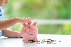Little boy putting coin into piggy bank (I love landscape) Tags: baby coin child coins family boy money cute home childhood table thailand piggy happy person pig kid hand little box small young bank save growth thai putting investment currency counting put wealth insert dropping finances school portrait girl beautiful smile asian chinese cash business planning future childs economy banking finance