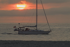 Sailboat at sunrise (Mawrter) Tags: sail sailboat sunrise peace peaceful sailing morning sun ocean atlanticocean nj newjersey nikon water nature boat cruise cruising voyage daybreak