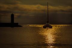 Bari sunrise (Leaning Ladder) Tags: bari italy italia puglia apulia sunrise silhouette boat water reflections canon 7d mkii 7dmkii leaningladder
