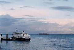 (Antía Davila) Tags: travel travelling portugal europe lisboa lisbon sunset sea urban film 35mm landscape mar dock do ship pentax k1000 coucher analogue cais sodre