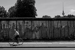 Bernauer Strasse (Douguerreotype) Tags: people monochrome bicycle blackandwhite deutschland street cyclist berlin mono germany architecture city urban wall bw bike