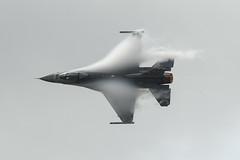 Condensing vapour forms around USAF F-16CM under low cloud (DrAnthony88) Tags: f16cmfightingfalcon96080480fsbasedspangdahlemairbase modernmilitary raffairford riatairshow royalinternationalairtattoo unitedstatesairforce viperdemonstrationteam england gloucestershire uk nikond500 nikonnikkorafs500mmf56epfedvr vapour condensation makingitsownclouds