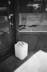 Liquid container (2) (Matthew Paul Argall) Tags: hanimex35es fixedfocus 35mmfilm blackandwhite blackandwhitefilm kentmere100 100isofilm