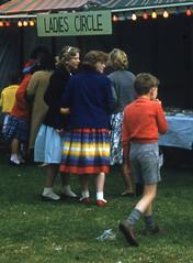 At the local fair (theirhistory) Tags: boy child children kid stall shirt shorts socks