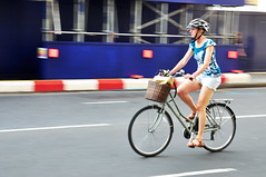 Panning shot of woman riding a bike through the city (Martyn.Hayes) Tags: cycle bicycle bike twowheels wheels leisure transport road london uk westminster basket woman helmet panningshot pan fast journey commute commuting summer streetphotography candid